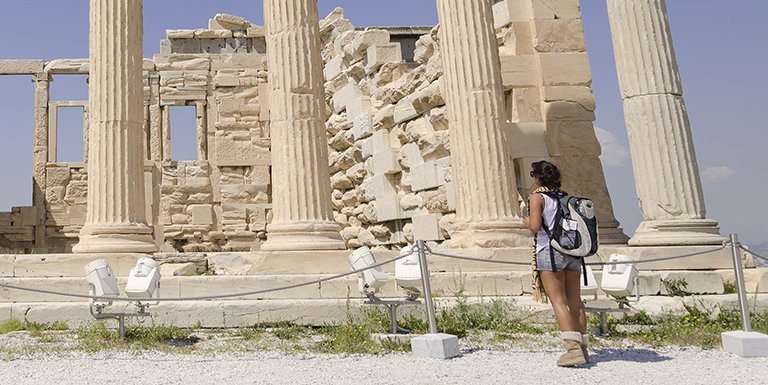 woman looking at ruins up close
