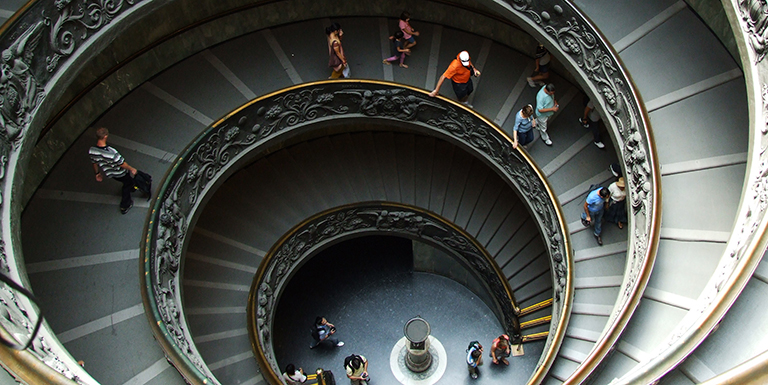 People walking down decorative staircase